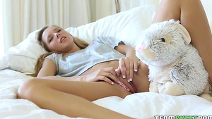 Young and tiny Hollie Mack playing with her stuffed bunny and shaved pussy!